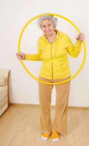 grandmother gymnastic exercises with hoop - help