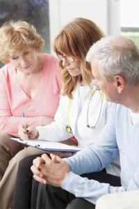 Doctor assisting seniors